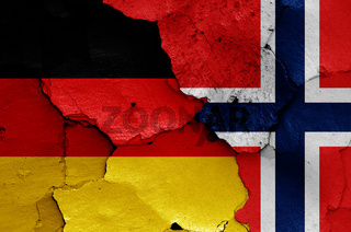 flags of Germany and Norway painted on cracked wall