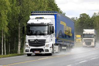 Freight Truck Traffic on Rainy Highway
