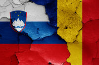 flags of Slovenia and Romania painted on cracked wall