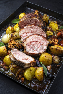 Traditional roasted veal roll roast offered with potatoes