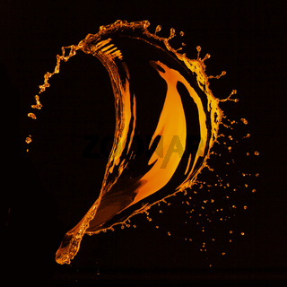 orange water splash isolated on black