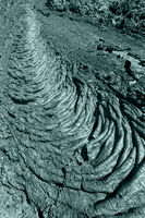 Creative volcanic background: undulating surface frozen lava flow which wrinkled in tapestry-like folds, rolls resembling twisted
