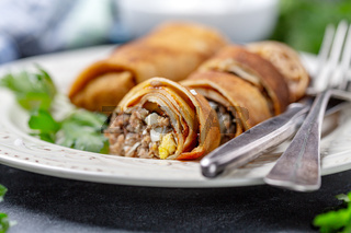 Crepes with minced beef, onions and eggs.