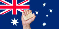 Caucasian male hand holding soap with words: Wash Your Hands against an Australian flag background