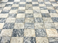 old floor of light and dark marble squares