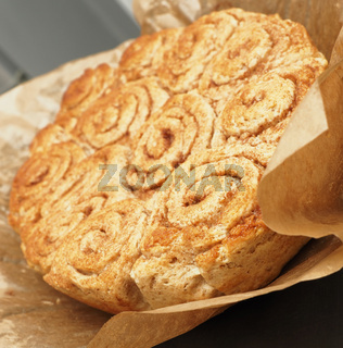 Sweet and tasty cinnamon pastry on baking paper