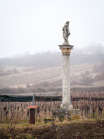Column with statue of saint sebastian in burgenland