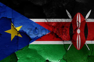 flags of South Sudan and Kenya painted on cracked wall
