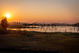 Sunset over dead trees, Nam Theun river, Thalang, Thakhek, Laos