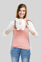 Blonde woman with a piggy bank