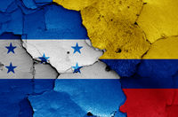 flags of Honduras and Colombia painted on cracked wall