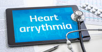 The word Heart arrythmia on the display of a tablet