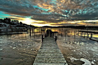 Pier in Fredrikstsd in Norway on the background of the sunset