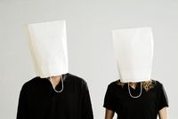 Couple with white paper bags on their heads