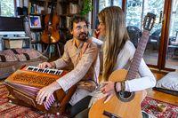 Shamanic couple playing musical instruments
