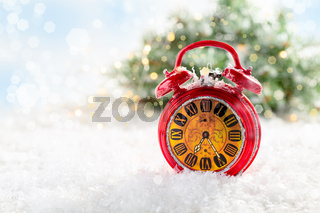 Christmas card with a red alarm clock.