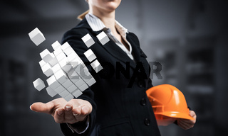 Businesswoman holds in palm abstract 3d cube