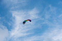 A kite on a blue sky with a gentle wind