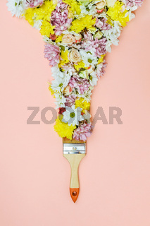 Bristle paint brush with various flowers on pink
