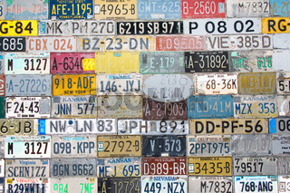 Background filled with various license plates
