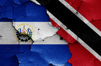 flags of El Salvador and Trinidad and Tobago painted on cracked wall