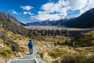 Wiew from Tasman Glacier walk with blue person in Mount Cook National Park, Aoraki, South Island, New Zealand