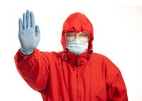Social distancing concept with person in protective red suit