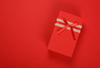 Red gift box with ribbon bow