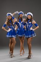 Showgirls in sailor style dresses shot