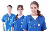 Team of doctors on white