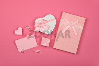 Valentine gift boxes and note over pink