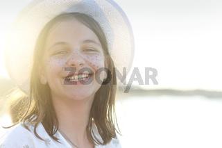 Cheerful teen girl on beach