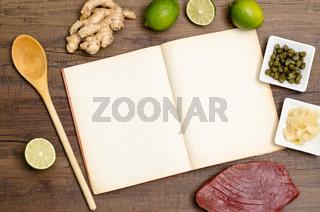 Kochbuch mit Kochlöffel und Textfreiraum