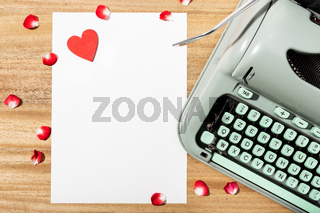 Love letter. Desk with blank paper, retro typewriter and red heart
