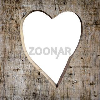 Heart shape carved into a plank