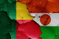 flags of Benin and Niger painted on cracked wall