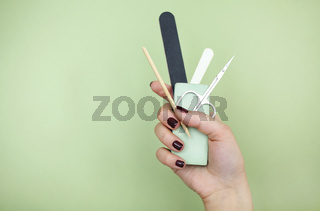 Crop woman with manicure supplies