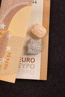 Ecstacy pills and eur bills.