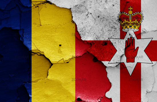 flags of Romania and Northern Ireland painted on cracked wall