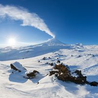 Best mountain travel destination for active vacation in winter season, snowy volcanic landscape, beauty eruption active volcano