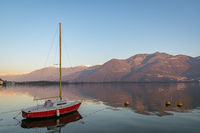wonderful red boat on stunning mountain Iseo lake