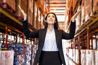 Asian businesswoman portrait in distribution warehouse