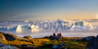 sitting, picnic, relax by the sea with icebergs in the fog, in the haze