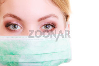 Closeup of woman in green face mask. Doctor or nurse isolated. Safety in risk work.