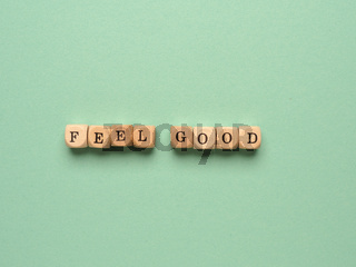 Feel good written with small wooden block