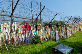 Prayer ribbons tied to the fence left by visitors wishing peace and unification for North and South Korea at the freedom bridge, DMZ, Gyeonggi, Republic of Korea