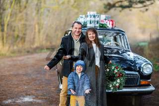 Stylish couple with son in park. Holiday concept