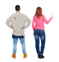 Back view of couple in sweater showing thumbs up.