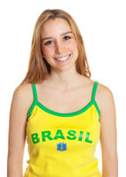 Brazilian soccer fan laughing at camera