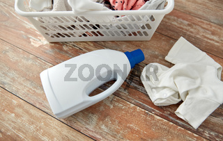baby clothes in laundry basket with detergent